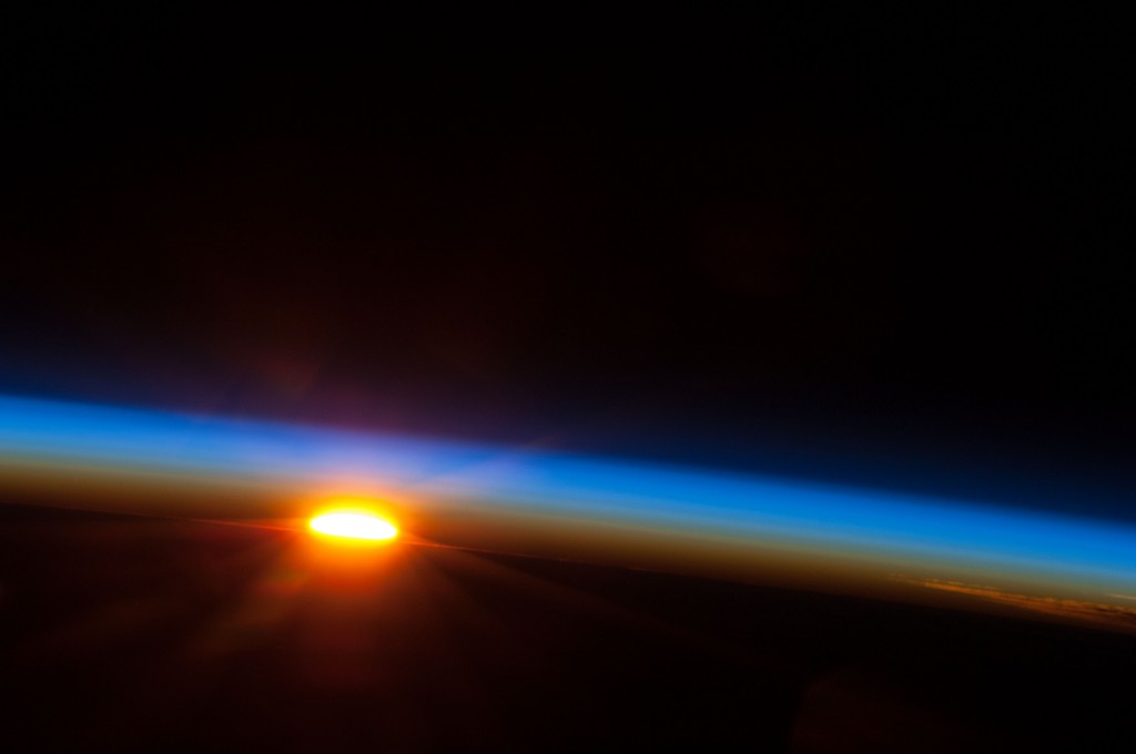 In this image provided by NASA the sun rises over the South Pacific Ocean photographed by one of the Expedition 35 crew members aboard the Earth-orbiting International Space Station between 4 and 5 a.m. local time, May 5, 2013. (AP Photo/NASA)